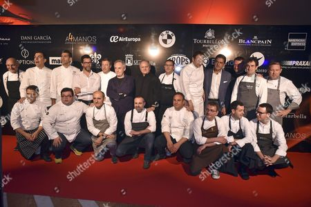 Nineteen Chefs who Join Seventy-one Michelin Stars Pose with Joel Robuchon (c Black Suit) Prior to the Dinner-tribute For French Cook Held at Mabella' S Puente Romano Hotel in Malaga Spain 18 April 2016 Spain Malaga