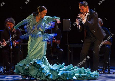 Spanish Flamenco Singer Miguel Poveda (r) Accompanied by Spanish Flamenco Dancer Eva Yerbabuena (l) Performs on Stage During the Granada International Festival of Music and Dance in Granada Southern Spain 08 July 2016 Spain Granada