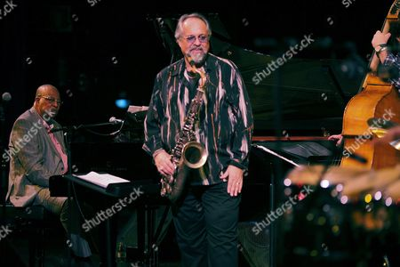 Stock Image of Cuban Pianist Chucho Valdes (l) and Us Saxophonist Joe Lovano (c) Perform on Stage During a Concert with the Chucho Valdes and Joe Lovano Quintet Band at the Cervantes Theater in Malaga Spain 25 October 2016 Spain Malaga