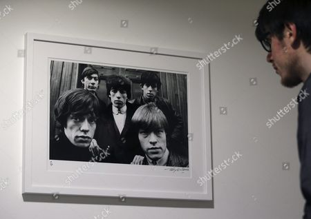 A Man Looks at a Photograph That is Part of the Exhibition 'Breaking Stones a Band on the Brink of Superstardom' at the Mondo Gallery in Madrid Spain 14 April 2016 the Exhibition Which Runs Fron 15 April to 30 May Gathers the Pictures of Terry O'neill and Gered Mankowitz From 1963 to 1965 and It is an Attemp to Follow the Band From Their Beginning Through to Becoming Rock Legends Spain Madrid
