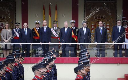 Spanish Acting Prime Minister Mariano Rajoy (r) Stands Beside (l to R) the Minister of Employment Fatima Banez; Minister of Interior Jorge Fernandez Diaz; Minister of Defense Pedro Morenes; Minister of Foreign Affairs Jose Manuel Garcia-margallo Speaker of the High Court Carlos Lesmes and Speaker of the Senate Pio Garcia Escudero Attend a National Day Parade in Madrid Spain 12 October 2016 National Day is Held to Celebrate the Anniversary of Christopher Columbus' First Arrival in the Americas in 1492 Spain Madrid