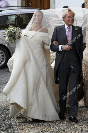Stock Image of Lady Charlotte Wellesley (l) Arrives with Her Father Charles Wellesley Duke of Wellington For Her Wedding with Colombian Billionaire Alejandro Santo Domingo (unseen) at the Chuch of the Incarnation in Illora Andalusia Southern Spain 28 May 2016 the Wellesley Family Owns a Country House in the Town Spain Granada