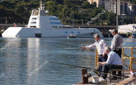 Three People Fish Next to the Yacht Called 'A' Property of the Russian Multimillionaire Andrey Melnichenko and Considered One of the World's Most Luxurious Boats Moors at Pasaia Port Guipuzcoa Basque Country Northern Spain 28 September 2016 the Yacht with a 119 Meters of Length by 19 Meters of Beam Will Remain at Least Four Days at the Port the Yacht Has Been Put on Sale For 300 Million Us Dollars Spain Pasaia