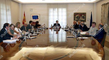 Acting Spanish Prime Minister Mariano Rajoy (6-r); Acting Spanish Vice-president Soraya Saenz De Santamaria (6l); Acting Ministers of Health Alfonso Alonso (l); Agriculture Isabel Garcia Tejerina (2l); Employment Fatima Ba±ez (3l); Treasury Cristobal Montoro (4l); Justice Rafael Catala (5l); Foreign Affairs Jose Manuel Garcia-margallo (5l); Defense Pedro Morenes (4r); Home Affairs Jorge Fernandez Diaz (3r); Education Inigo Mendez De Vigo (2r); and Economy Luis De Guindos (r) Attend a Cabinet Meeting at the Moncloa Presidential Palace in Madrid Spain 05 August 2016 Spain Madrid