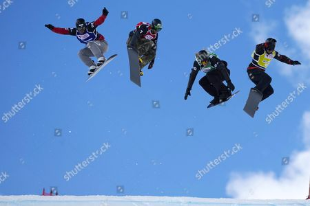 Stock Photo of Japanese Snowboarder Shinya Momono (l) Spanish Lucas Eguibar (2-l) Us Hagen Kearney (2-r) and Canadian Christopher Robanske (r) in Action During the Men's Final of the Snowboard Cross World Cup 2016 at the Ski Resort of Baqueira Beret Lleida Northeastern Spain 20 March 2016 Spain Baqueira Beret
