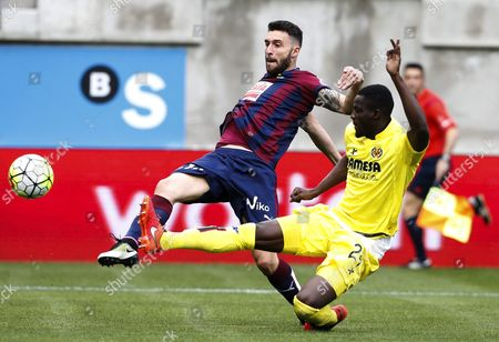 Stock Picture of Eibar's Forward Eibar Borja Gonzalez (l) Vies For the Ball with Villarreal's Defender Eric Bertrand Bailly From Ivory Coast During Their Primera Division Liga Matzh Held at the Ipurua Stadium in Eibar Spain on 03 April 2016 Spain Eibar