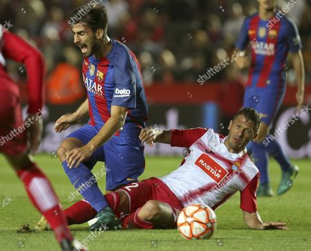 Rcd Espanyol's Argentinean Defender Martin Demichelis (r) Fouls Portuguese Andre Gomes (l) of Fc Barcelona During the Catalunya's Supercup Final Match Played at the Nou Estadi in Tarragona Northeastern Spain 25 October 2016 Spain Tarragona