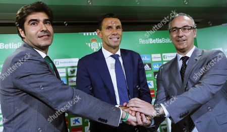 Real Betis' New Uruguayan Head Coach Gustavo Poyet (c) Poses For Photographers with Real Betis' President Angel Haro (l) and Sports Director Miguel Torrecilla (r) During a Press Conference For Poyet's Presentation As New Coach of the Spanish Primera Division Soccer Club at Benito Villamarin Stadium in Seville Southern Spain 11 May 2016 Gustavo Poyet Signed a Two-year Contract with Real Betis Spain Seville