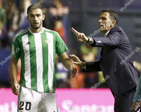 Real Betis's Head Coach Gustavo Poyet (r) Gives Instructions to His Player German Pezzella (l) During the Primera Division Soccer Match Between Ca Osasuna and Real Betis at El Sadar Stadium in Pamplona Spain 21 October 2016 Spain Pamplona