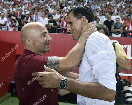 Sevilla's Coach Jorge Sampaoli (l) Greets Real Betis Coach Gustavo Poyet (r) Before the Spanish Primera Division Soccer Match Between Sevilla and Betis at Sanchez Pizjuan Stadium in Seville Spain 20 September 2016 Spain Seville