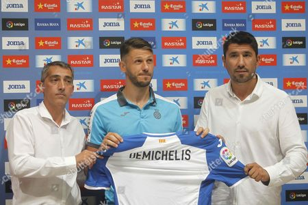 Rcd Espanyol's Managing Director Ramon Robert (l) and Sport Director Angel Gomez (r) Pose For Photographs with Argentinian Defender Martin Demichelis (c) During His Presentation As New Player For Spanish Team Rcd Espanyol in Cornella Barcelona Northeastern Spain 11 August 2016 the Player From Manchester City Signed One Season Contract with the Primera Division Team Spain Cornella