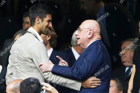 Serbian Tennis Player Novak Djokovic (l) Greets Ac Milan's Ceo Adriano Galliani (r) During the Uefa Champions League Semi Final Second Leg Soccer Match Between Real Madrid and Manchester City at Santiago Bernabeu Stadium in Madrid Spain 04 May 2016 Spain Madrid
