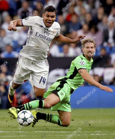 Real Madrid's Brazilian Midfielder Casemiro (l) in Action Against Sporting's Joao Pereira During the Uefa Champions League Group Stage Match Between Real Madrid and Sporting Cp at Santiago Bernabeu Stadium in Madrid Spain 14 September 2016 Spain Madrid