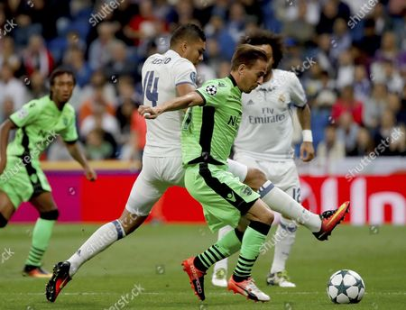 Real Madrid's Brazilian Midfielder Carlos Henrique Casimiro (l) and Sporting Portugal's Joao Pereira Fight For the Ball During Their Uefa Champions League Group Stage Match at Santiago Bernabeu Stadium in Madrid Spain 14 September 2016 Spain Madrid