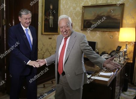 Spanish Acting Foreign Minister Jose Manuel Garcia-margallo (r) Welcomes Slovenian Former President and Candidate For the Post of Secretary-general of the United Nations Danilo Turk During Their Meeting at Santa Cruz Palace in Madrid Spain 21 July 2016 Spain Madrid