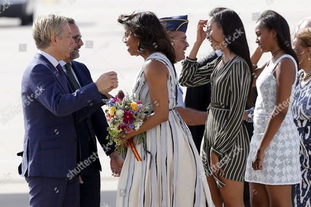 Us Ambassador to Spain James Costos (2-l) and His Husband Michael Smith (l) Welcome Us First Lady Michelle Obama (c) and Her Daugthers Malia (2-r) and Sasha (r) As They Arrive at the Military Base of Torrejon De Ardoz Madrid Spain 29 June 2016 Michelle Obama is in Spain As Part of Her Trip to Promote Let Girls Learn Initiative Which was Launched in March 2015 to Help Promote Education For Around 62 Million Young Girls Around the World who Are not in School Her Three-nation Trip Will Also Take Michelle Obama to Morocco and Spain where She Will Meet with Spanish Queen Letizia on Thursday President Barack Obama is Also Scheduled to Visit Spain on 09 July Spain Torrejon
