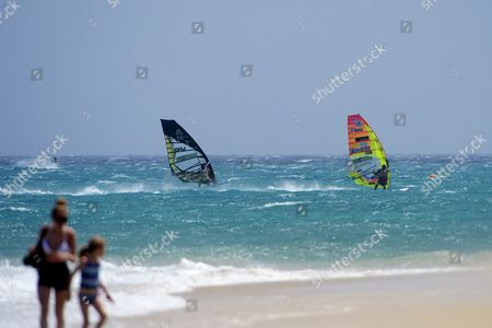 Antoine Albeau of France (r) and Matteo Iachino of Italy Compete During the First Round of the Windsurfing World Slalom Championships of Fuerteventura at Costa Calma Canary Islands Spain on 27 July 2016 the World Slalom Championships of Windsurf Started Today at Sotavento Beach Spain Costa Calma (fuerteventura)