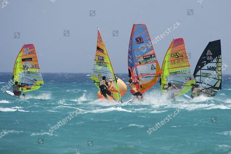 Antoine Albeau of France (fr192) Arnon Dagan of Israel (isr1) Cedric Bordes (fra91) and Nicolas Warembourg (f531) of France and Matteo Iachino of Italy (i140) Compete During the First Round of the Windsurfing World Slalom Championships of Fuerteventura at Costa Calma Canary Islands Spain on 27 July 2016 the World Slalom Championships of Windsurf Started Today at Sotavento Beach Spain Costa Calma (fuerteventura)