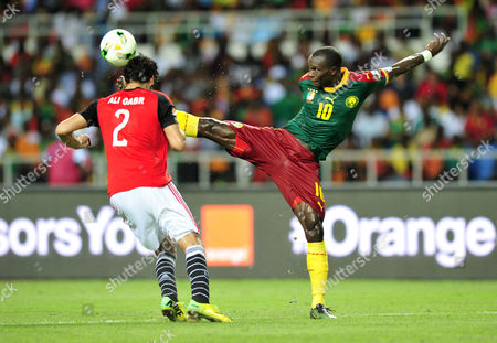 Vincent Aboubakar (R) of Cameroon challenged by Ali Gabr (L) of Egypt