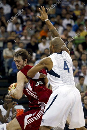 Turkish Basketball Player Semih Erden Trying to Brake Us Defence with Carlos Boozer During Their Basketball Game Between Usa and Turkey at the Venitian Macau Arena in Macau China 31 July 2008 the Usa Won 114 to 84 China Macau