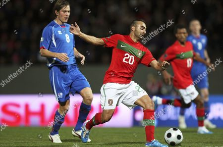 Portuguese Player Carlos Martins (r) Vies For the Ball with Iceland's Olafur Skulason (l) During the Uefa Euro 2012 Group H Qualifying Soccer Match at Laugardalsvollur Stadium in Reykjavik Iceland 12 October 2010 Portugal Won 3-1 Iceland Reykjavik