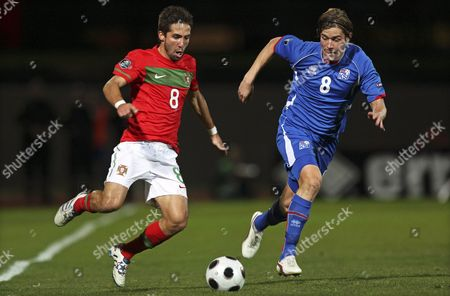 Portuguese Player Joao Moutinho (l) Vies For the Ball with Iceland's Olafur Skulason During the Uefa Euro 2012 Group H Qualifying Soccer Match at Laugardalsvollur Stadium in Reykjavik Iceland 12 October 2010 Portugal Won 3-1 Iceland Reykjavik