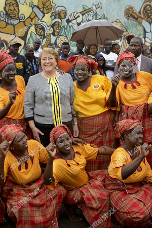 President of Chile Michelle Bachelet (c-l) Poses with Singers and Dancers During Her Mozambique Visit in Maputo Mozambique 11 August 2014 Bachelet Continued Her Visit to Southern Africa with a Meeting in Maputo with Counterpart Armando Guebuza She Will Fly Later in the Day to Luanda For a Two-day Official Visit Mozambique Maputo