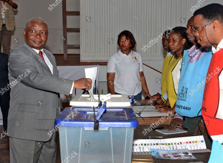 Mozambique President Armando Guebuza (l) Casts His Vote at a Polling Station in Maputo Mozambique 15 October 2014 Mozambicans Started Voting on 15 October in Elections Seen As a Test For Peace Following a Deal Between the Government and the Armed Opposition Party Renamo to End a Two-year Insurgency More Than 10 Million People Are Eligible to Vote For the President Parliament and Provincial Assemblies at About 17 000 Polling Stations Mozambique Maputo
