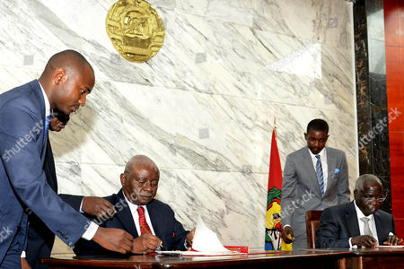 President of Mozambique Armando Guebuza (3-l) Sits Alongside the Leader of the Renamo (resistencia Nacional Mocambicana) Movement Afonso Dhlakama (r) During the Government-renamo Peace Agreement Ceremony Held at Maputo Mozambique 05 September 2014 Dhlakama Came out of Hiding For the Conclusion of Peace Negotiations Ending Almost Two Years of Low Level Warfare Between the Movement and the Mozambique Government After Leaving Maputo During the Political Crisis Following the Defeat of Renamo in the General Election of 2009 Mozambique Maputo