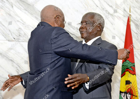 Leader of the 'Renamo' (resistencia Nacional Mocambicana) Movement Afonso Dhlakama (r) and President of Republic of Mozambique Armando Guebuza (l) Greet Each Other During the Government-renamo Peace Agreement Ceremony Held in Maputo Mozambique 05 September 2014 Dhlakama Came out of Hiding For the Conlcusion of Peace Negotiations Ending Almost Two Years of Low Level Warfare Between the Movement and the Mozambique Government After Leaving Maputo During the Political Crisis Following the Defeat of Renamo in the General Election of 2009 Mozambique Maputo