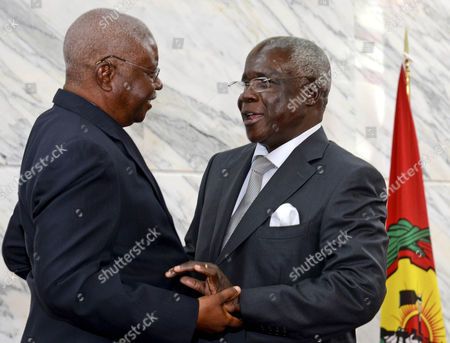 The Leader of the Renamo (resistencia Nacional Mocambicana) Movement Afonso Dhlakama (r) and the President of Mozambique Armando Guebuza (l) Embrace During the Government-renamo Peace Agreement Ceremony Held at Maputo Mozambique 05 September 2014 Dhlakama Came out of Hiding For the Conclusion of Peace Negotiations Ending Almost Two Years of Low Level Warfare Between the Movement and the Mozambique Government After Leaving Maputo During the Political Crisis Following the Defeat of Renamo in the General Election of 2009 Mozambique Maputo