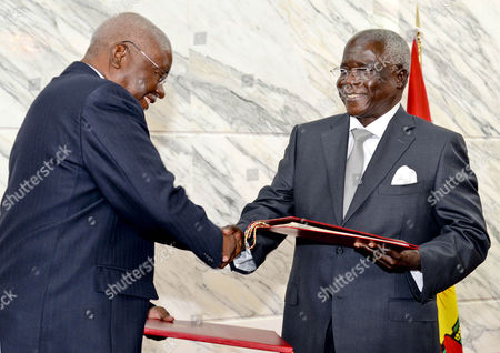Leader of the Renamo (resistencia Nacional Mocambicana) Movement Afonso Dhlakama (r) and Mozambique President Armando Guebuza (l) Smile As They Greet Each Other During the Government-renamo Peace Agreement Ceremony in Maputo Mozambique 05 September 2014 Dhlakama Came out of Hiding For the Conclusion of Peace Negotiations Ending Almost Two Years of Low Level Warfare Between the Movement and the Mozambique Government After Leaving Maputo During the Political Crisis Following the Defeat of Renamo in the General Election of 2009 Mozambique Maputo