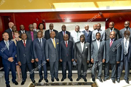 Leader of the Renamo (resistencia Nacional Mocambicana) Movement Afonso Dhlakama (bottom 4-l) and President of Mozambique Armando Guebuza (bottom C) Stand with Their Negotiation Teams During the Government-renamo Peace Agreement Ceremony Held at Maputo Mozambique 05 September 2014 Dhlakama Came out of Hiding For the Conclusion of Peace Negotiations Ending Almost Two Years of Low Level Warfare Between the Movement and the Mozambique Government After Leaving Maputo During the Political Crisis Following the Defeat of Renamo in the General Election of 2009 Mozambique Maputo