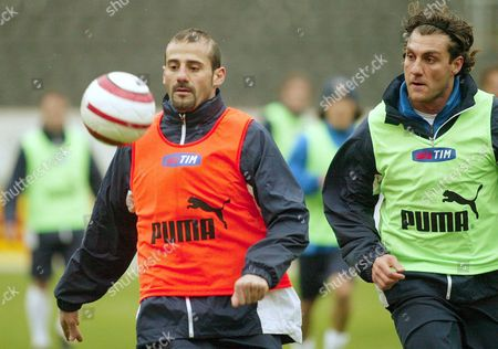 Giuseppe Pancaro (l) and Christian Vieri Fight For the Ball During the Italian National Soccer Team Training Session 30 March 2004 at D Afonso Henriques Stadium to Prepare the Upcoming Friendly Match Against Portugal Portugal Braga