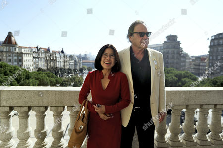 Us Filmmaker Oliver Stone (r) Poses with His Wife Sun-jung Jung After Being Honored with the Medal of Honor of the City During a Ceremony in Porto Portugal 26 September 2014 Portugal Porto