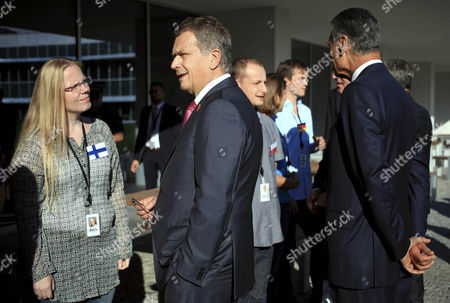 President of Finland Sauli Vainamo Niinisto Greets a Citizen of Finland During the Visit to of the International Iberian Nanotechnology Laboratory Before the Arraiolos Group Meeting in Braga Portugal 30 September 2014 the Meeting is Held Between the Eu's Parliamentary Democracies' Heads of States with Italian and Slovenian Presidents not Present Portugal Braga