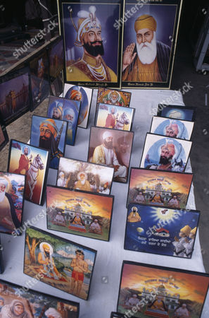 Stock Picture of Souvenir pictures of Sikh gurus for sale. Amritsar Punjab INDIA