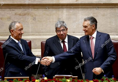 New President of Republic of Portugal Marcelo Rebelo De Sousa (l) Shakes Hands with the Outgoing President Anibal Cavaco Silva (r) Accompanied by Republic Assembly President Eduardo Ferro Rodrigues (c) During His Swearing Ceremony at the Portuguese Parliament in Lisbon Portugal 09 March 2016 Portugal Lisbon