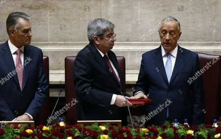 Marcelo Rebelo De Sousa (r) is Sworn-in As Portuguese President with Assembly President Eduardo Ferro Rodrigues Eduardo Ferro Rodrigues (c) As Outgoing President Anibal Cavaco Silva Stands by at the Portuguese Parliament in Lisbon Portugal 09 March 2016 Portugal Lisbon