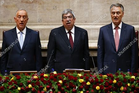 Stock Picture of New President of Republic of Portugal Marcelo Rebelo De Sousa (l) Outgoing President Anibal Cavaco Silva (r) and Republic Assembly President Eduardo Ferro Rodrigues (c) Sing the Portuguese National Anthem During the Swearing Ceremony at the Portuguese Parliament in Lisbon Portugal 09 March 2016 Portugal Lisbon