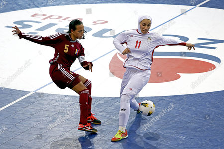 Stock Picture of Iran Team Player Niloofar Ardallani (r) Fights For the Ball with Barbara Sanchez of Venezuela During the Match For the Iii Women Indoor Soccer Championship Held at Salvador Machado Pavillion at Oliveira De Azemeis Portugal 03 December De 2012 Portugal Oliveira De Azemeis