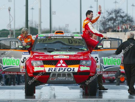 France's Mistubishi Drivers Luc Alphand (r) and Michel Gilles Picard Wave Before Leaving From Praca Do Imperio in Lisbon 31 December 2005 For the 28th Edition of the Dakar Rally Portugal Lisbon