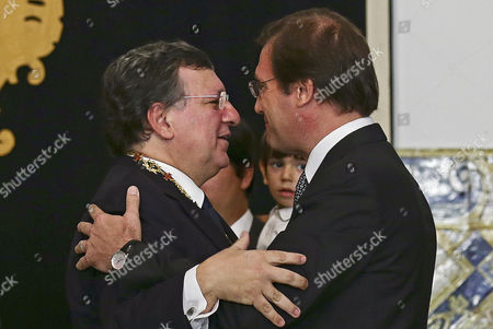 Former European Commission President Jose Manuel Barroso (l) is Congratulated by Portuguese Prime Minister Pedro Passos Coelho (r) After Being Bestowed with the Grand Collar of Order of Prince Henry the Navigator by the Portuguese President Cavaco Silva (not Pictured) During a Ceremony at Belem Palace in Lisbon Portugal 03 November 2014 the Order of Prince Henry is Bestowed For Exceptional and Outstanding Merit For Portugal and Its Culture Portugal Lisbon