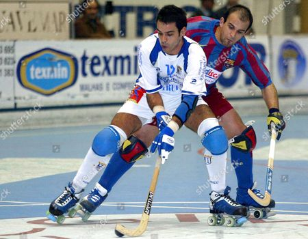 Oquei De Barcelos?s Nuno Resende (f) Fights For the Ball with Fc Barcelona?s Carlos Lopez During Their Champions League Rinke Hockey Match on Saturday 24 February 2007 at the Municipal De Barcelos Pavilion in Barcelos North of Portugal Portugal Barcelos