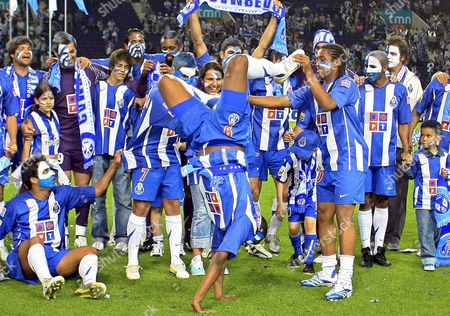 Porto Player South African Benny Mccarthy Walks on His Hands with the Help of Brazilian Anderson (r) As the Team Celebrate the Portuguese League Title After the Match Against Guimaraes in Portuguese First Division Match at Dragao Stadium in Porto Sunday 30 April 2006 Portugal Porto