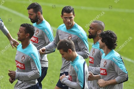 Portuguese National Soccer Team Players Cristiano Ronaldo (c) of Real Madrid Danny (2-l) of Zenit Nanni (l) of Sporting Jose Bosingwa (2-r) of Trabzonspor Tiago of Athletic of Madrid (r) Cedric Soares (down) of Sporting During Their Team's Training Session at Luz Stadium in Lisbon Portugal 16 November 2014 Portugal Will Face Argentina on a Friendly Match Next 18 November at Old Trafford in England Portugal Lisbon