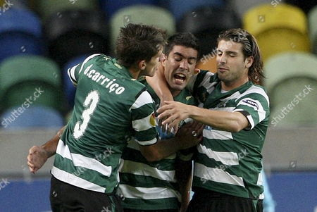 Sporting of Lisbon Players Daniel Carri?o (l) Carlos Saleiro (c) and Miguel Veloso Celebrate the Scoring of a Goal Against Fk Ventspils During the Uefa Europa League Group D Soccer Match at Alvalade Xxi Stadium Lisbon Portugal 5 November 2009 Portugal Lisbon