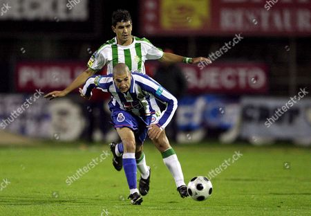 Setubal Soccer Player Ricardo Chaves (back) Fights For the Ball with Lisandro (front) of Fc Porto During Their First League Soccer Match at Bonfim Stadium in Setubal Portugal 12 April 2008 Portugal Setubal