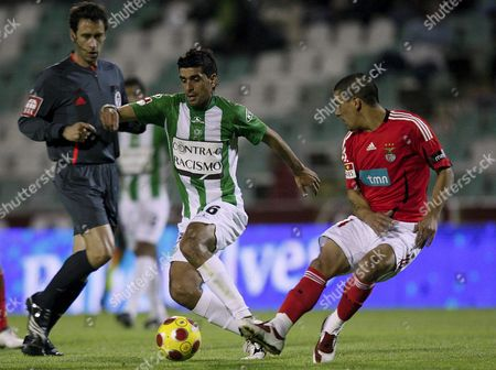 Vitoria De Setubal Player Ricardo Chaves Figths For the Ball with Benfica's Maxi Pereira During Their Portugueses First Division Soccer Match at Bonfim Stadium in Setubal Portugal 19 April 2009 Portugal Setubal