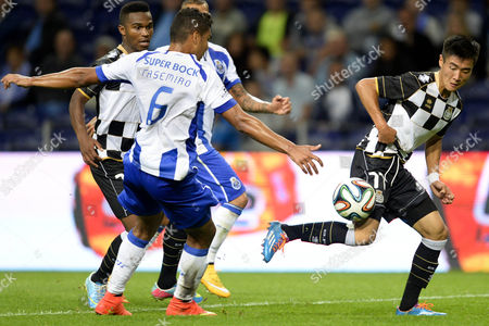 Fc Porto's Carlos Casemiro (l) Vies For the Ball with Boavista's Wei Shihao During the Portuguese First League Soccer Match Between Porto and Boavista Held at Dragao Stadium in Porto Portugal 21 September 2014 Portugal Porto